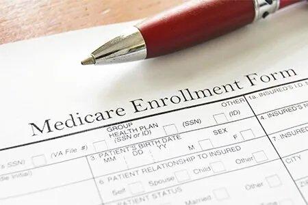 Medicare Insurance — Medicare Enrollment Form and a Pen in Peoria, AZ